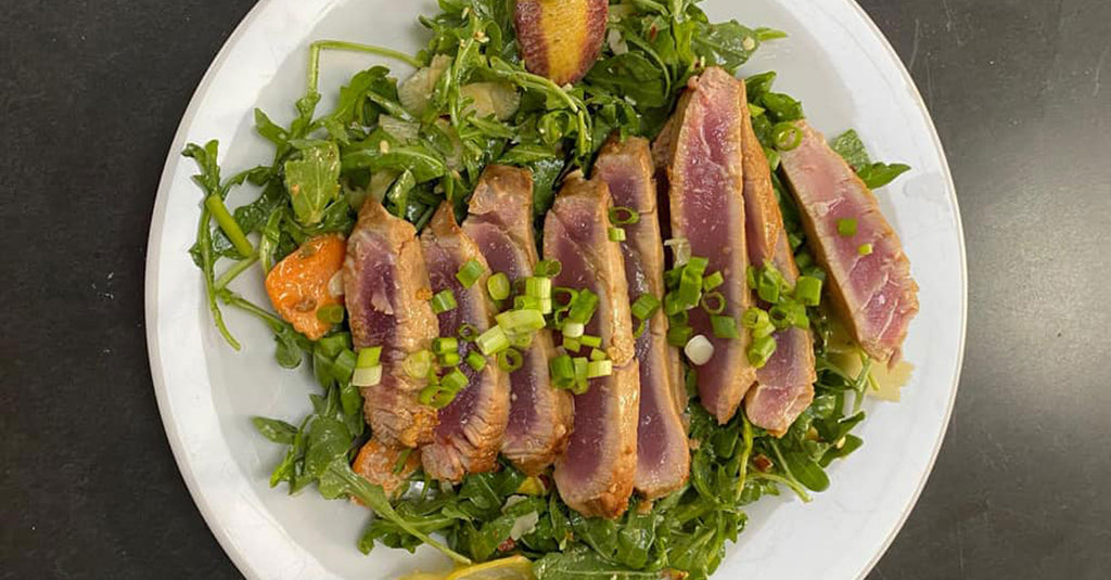 Seared tuna over bed of greens