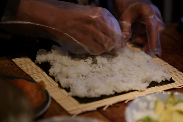 spreading rice on nori sheet