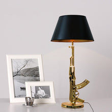 Load image into Gallery viewer, Gun Table Lamps (Available in Gold or Silver)