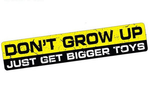 """Don't Grow Up, Just Get Bigger Toys""  Vinyl Decal/Sticker"
