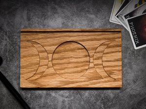 The Large wooden moon stand which has a full moon in the center and a crescent moon facing outward on either side.