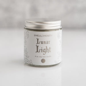Front view of the Lunar Light candle by Emerald Hearth.  The candle has white packaging.