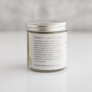 Back view of the Lunar Light candle by Emerald Hearth.  The candle has white packaging.