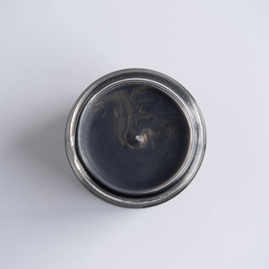Aerial view of the New Moon Muse candle which has golden sparkles on the top.