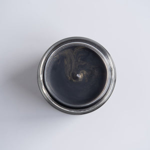 The top of the New Moon Mini which is black with golden accents.  Photographed on a black background.