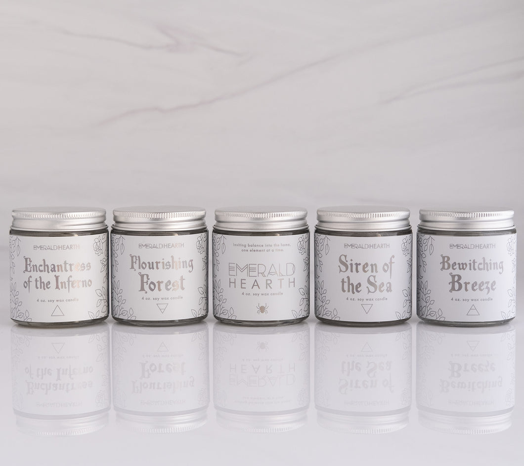 Five candles in the essential mini candle bundle set on a white background.  All candles are made by emerald hearth.