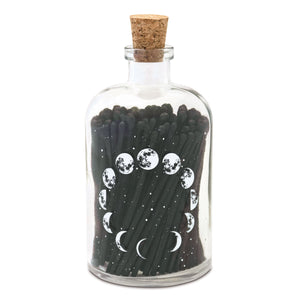 The Moon Phase matches which are black in a mini apothecary bottle.  The bottle has the moon phases printed on it.  The bottle has a cork.  This item is sold by Emerald Hearth Creations.