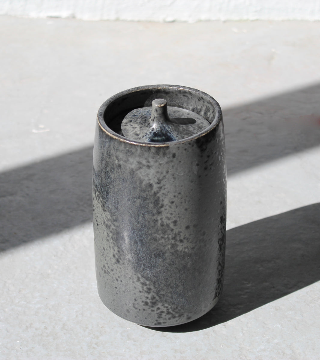 '#139' Tall Pot with Finger-Pinched Lid <br> Black Glaze