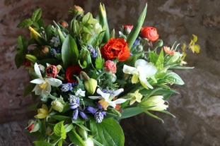 We are still open and delivering flowers....