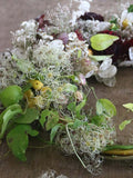 Join Flower Farmer and Florist Georgie Newbery as she shows you how to make a fabulous autumn wreath out of entirely foraged materials from her gardens at Common Farm in Somerset.   Using twigs and berries, seed heads, foliage, and dried flowers, she'll show you how to twist together a rustic circle of twigs, and how to create a garland of goodies with which to dress it.