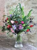 Our Christmas hand tied bouquets are bursting with seasonal flowers, in colours you will immediately associate with the festive season, as well as beautiful English foliage. And they come with the promise of spring in the scented Cornish narcissi dotted throughout the bouquet. Available in three different sizes.
