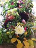 Our hand tied funeral sheaf of seasonal British grown flowers is a beautiful tribute for your loved one. This stunning sheaf is designed to be placed on a coffin and it is created from seasonal blooms, freshly cut from our flower patch.