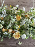 On this online workshop flower farmer Georgie Newbery shows you how to make a no-floral-foam focal piece for a wedding or event. This session will suit people keen to work without floral foam in their floristry, and learn how to use wilder elements to effect.  Wedding flowers, DIY weddings, flower arranging workshop.