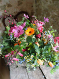 Four flower deliveries a year: a hedgerow dressed willow wreath at Christmas, a spring bouquet in April, a summer bouquet in June, and an autumn bouquet in September. All exclusively British grown flowers, grown, cut and tied at Common Farm Flowers.