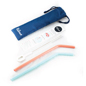 A set of two silicone straws; coral color and blue paradise color. A set comes with one cleaning brush and one reusable bag.