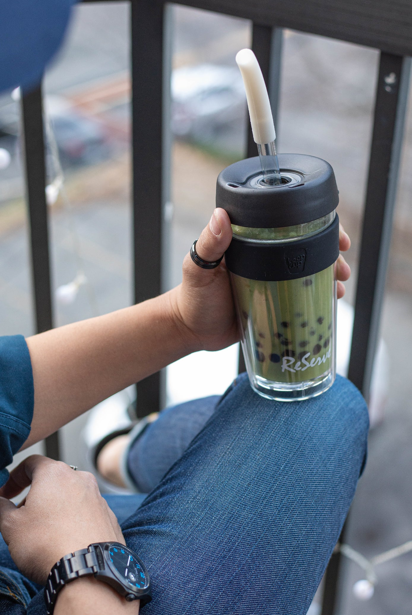 Silver bubble tea straw in ReServe KeepCup of  matcha milk tea with boba/pearl
