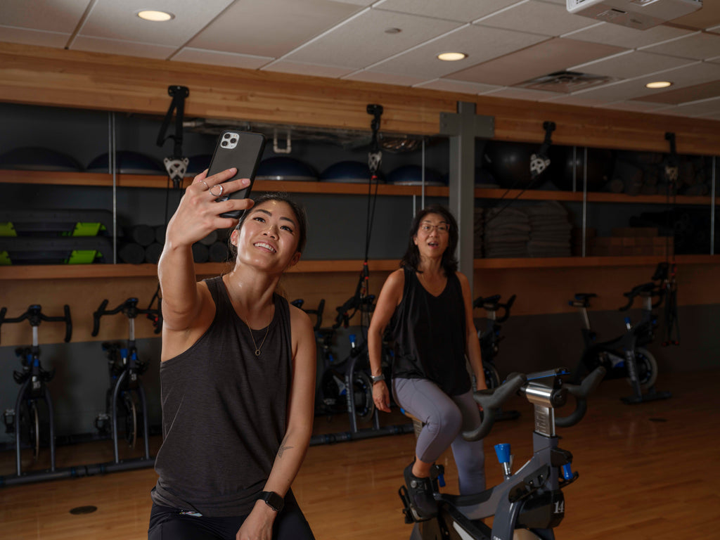 Taking a picture with mom while indoor cycling