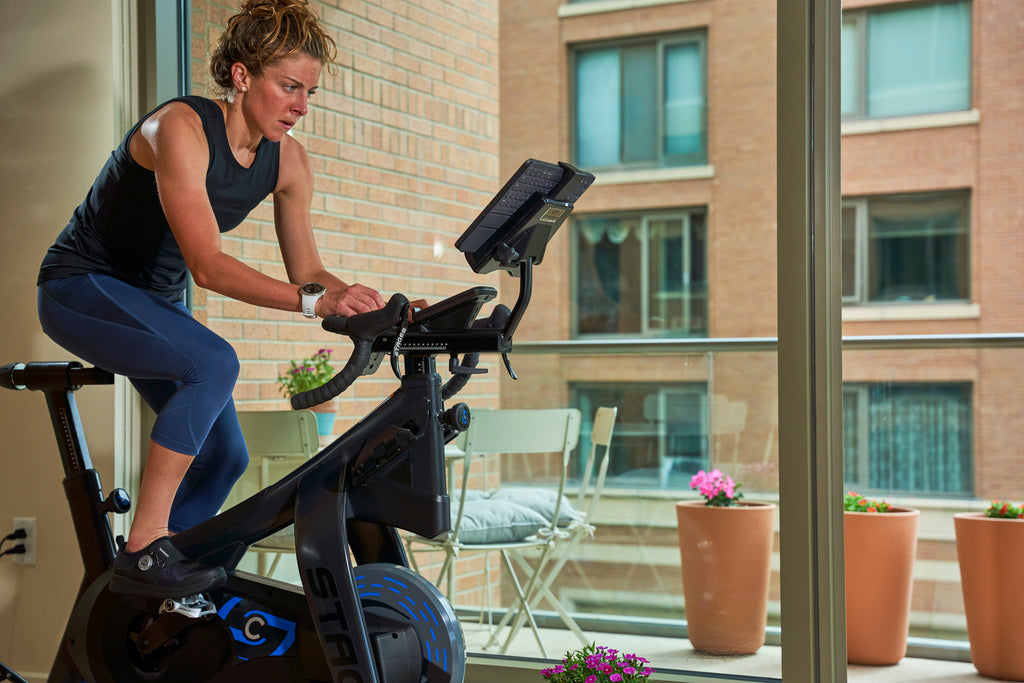getting a work out in on a spin bike with shimano indoor cycling shoes