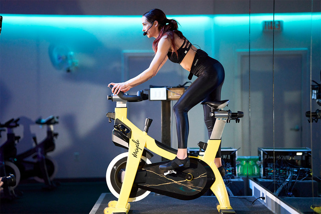 Female spin instructor using Shimano's new IC200 SPD compatible Indoor Cycling Shoe
