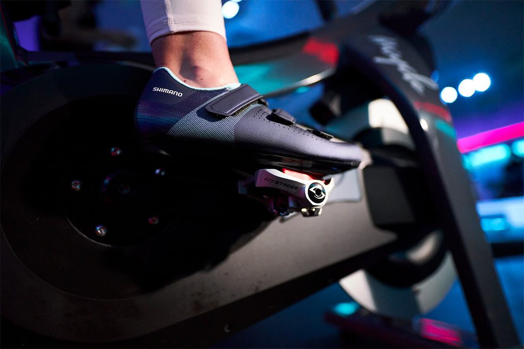 Shimano Indoor Cycling SH-RC100 Indoor cycling shoes clipped into a Stages stationary bike