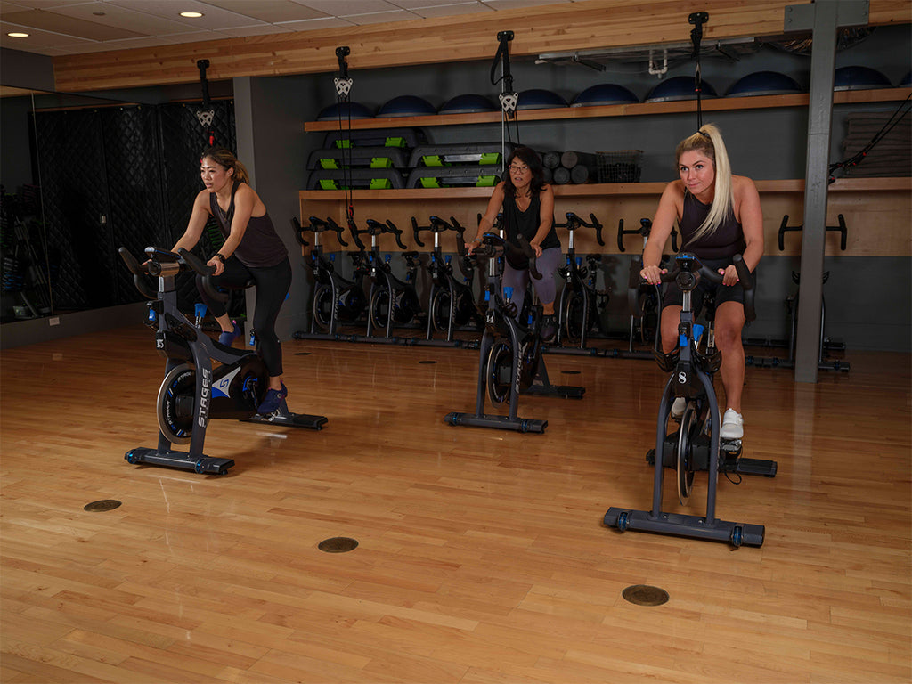 Group of women indoor cycling wearing shimano indoor cycling shoes