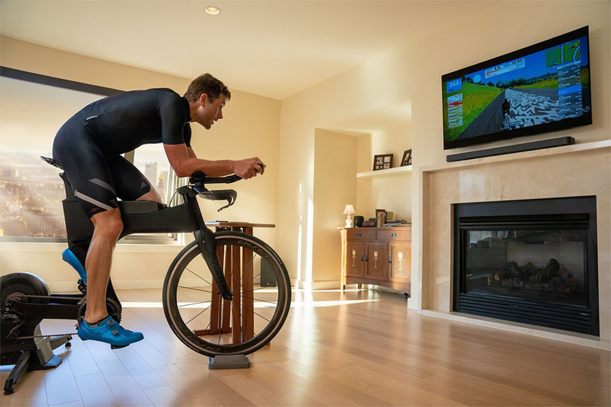 Man riding an indoor trainer on his TT bike and using Shimano cycling shoes