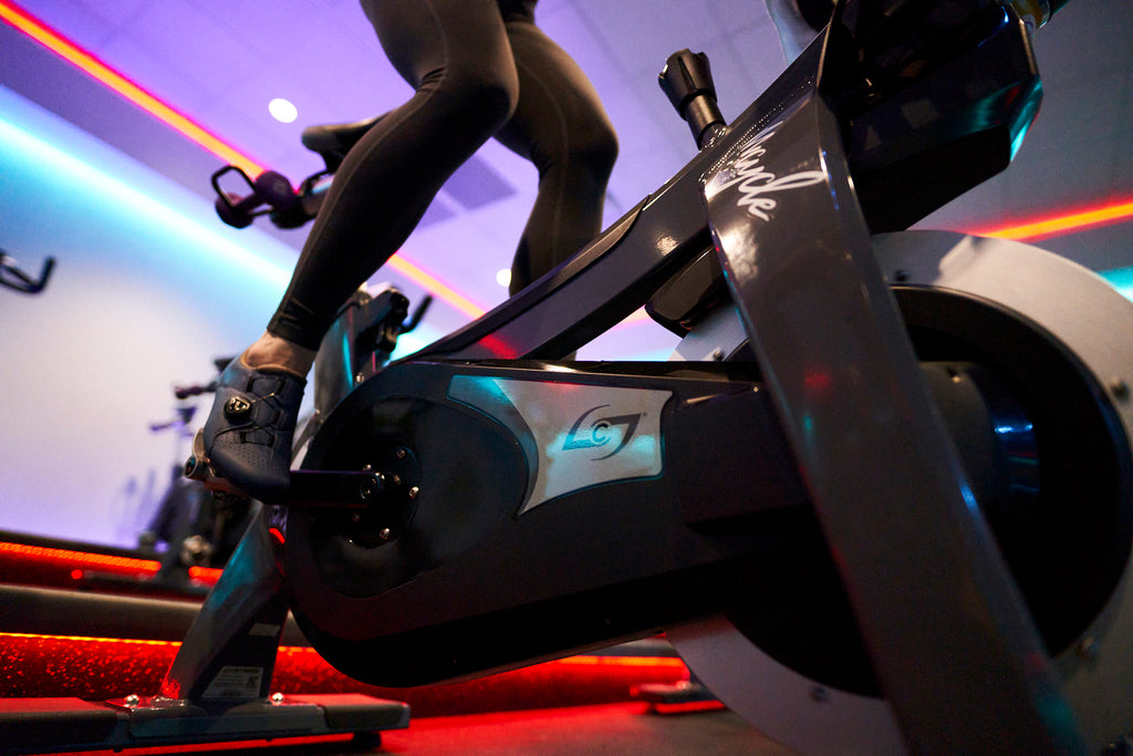 Clipping in while indoor cycling at a spin studio