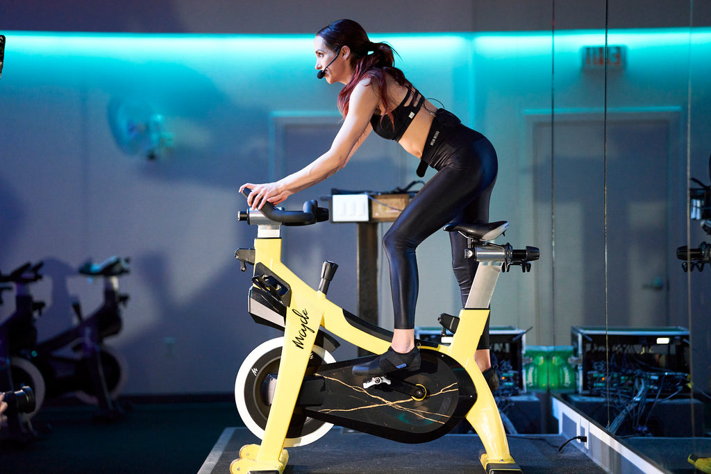 Indoor cycling Studio instructor teaching a class