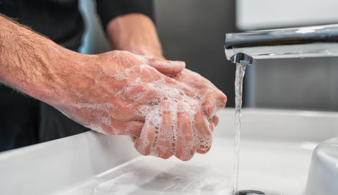 close up of hand washing with soap