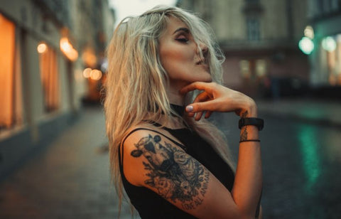 blonde woman with shoulder tattoo
