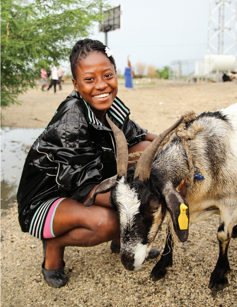 Girl with goat.
