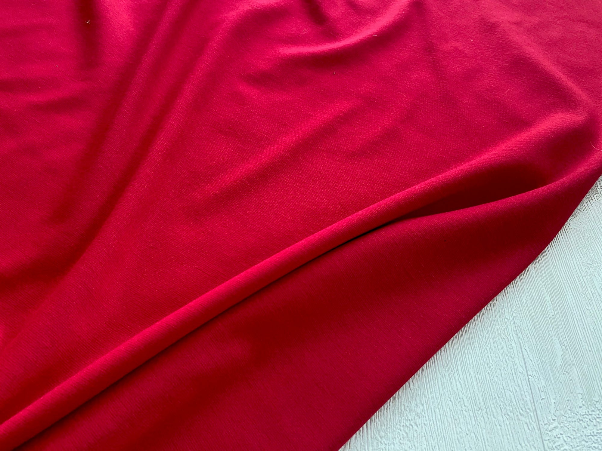 Red Ponteroma jersey €12 per mtr