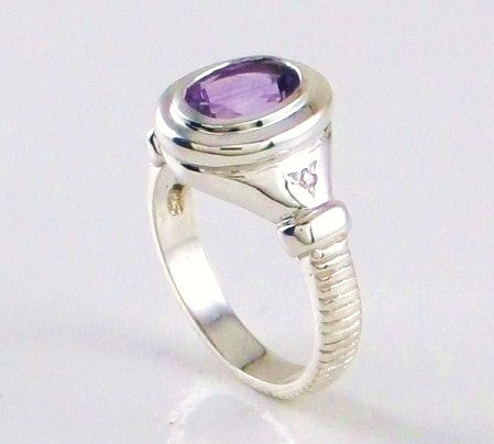 "Bezel set gemstone ring with ""coin edge"" motif"