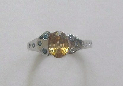 Golden Burmese Zircon and Diamond Ring