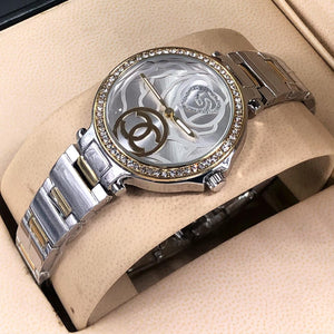 Chanel Unique Wrist Watch For Women with Embossed Flower Dial plus Crystal Ring Bahria Stores by AnzorStore in Wrist Watch