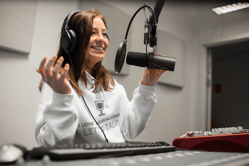 Radio jockey sister wearing personalized hoodie gifted by brother