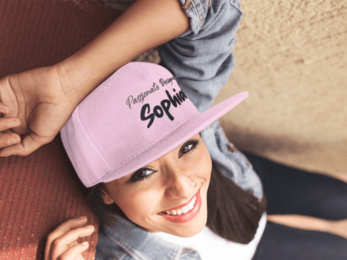 Girl with personalized hat gifted to herself