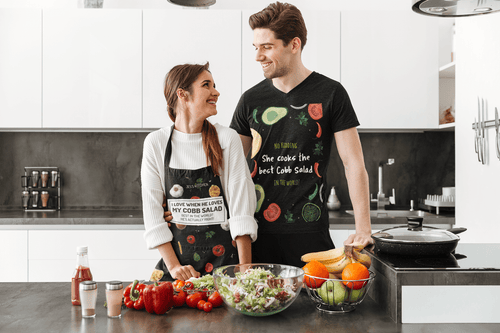 Couples with personalized aprons cooking in the kitchen
