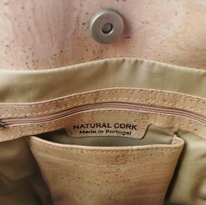 Natural and brown cork fabric bucket bag with bow, inside view with phone compartment