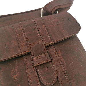 Brown cork fabric messenger bag for men, vegan and eco-friendly, front closure detail
