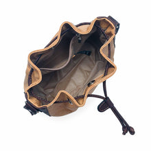 Load image into Gallery viewer, Natural and brown tinted cork fabric bucket bag with drawstring, view from top, open