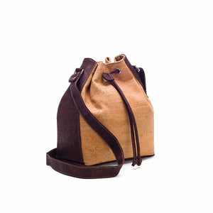 Natural and brown tinted cork fabric bucket bag with drawstring, side view