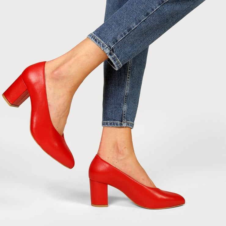 red heels on a woman in jeans