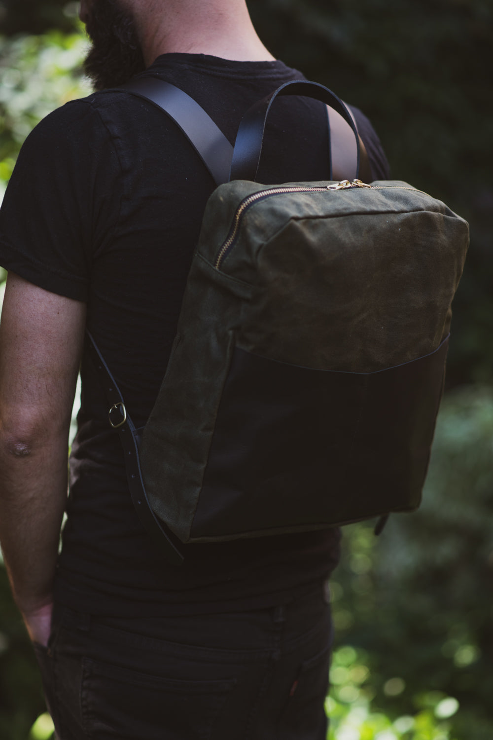 Veinage Gilford black leather and army green waxed canvas backpack