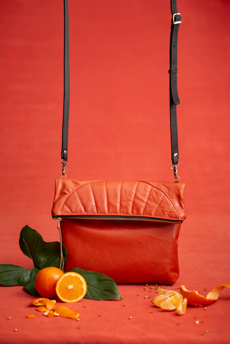 ORANGE leather clutch bag with crossbody strap
