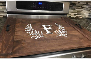 Stove top cover with feathered border
