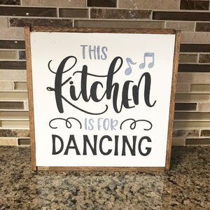 In the kitchen we dance sign.