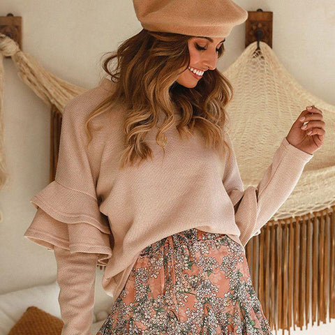 Fashion blog: 9 types of sweaters you need in your closet - woman wearing flare sleeve loose sweater