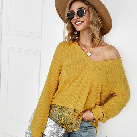 Fashion blog: 9 types of sweaters you need in your closet - woman wearing lace patchwork sweater