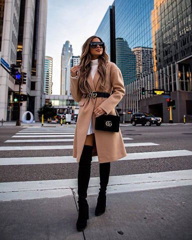 camel coat and knee high boots